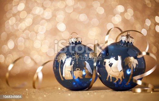 Christmas Nativity Scene and The Three Kings Baubles on a Gold Defocused Lights Background