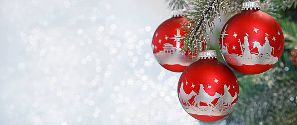 Christmas nativity scene on red hanging Christmas ornaments stock photo