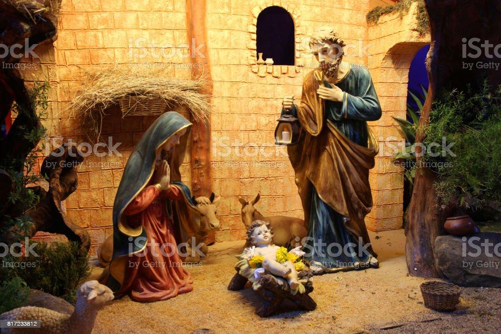 Christmas nativity scene with figurines including Jesus, Mary, Joseph, and sheeps stock photo