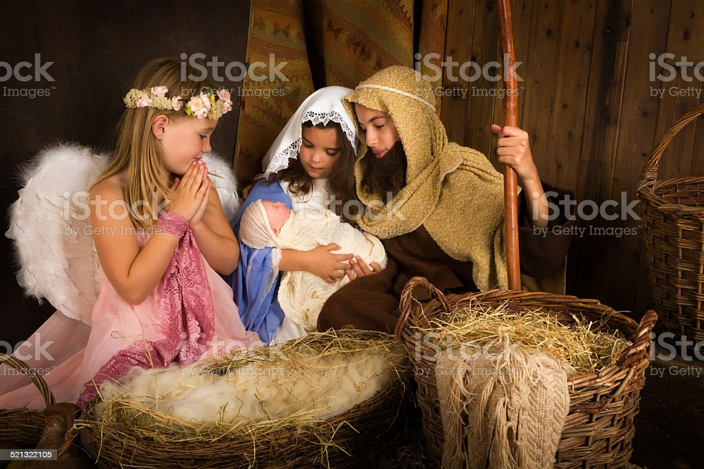 Christmas nativity with angel stock photo