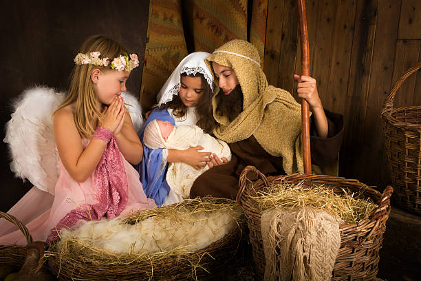 christmas nativity with angel - nativity scene stock pictures, royalty-free photos & images
