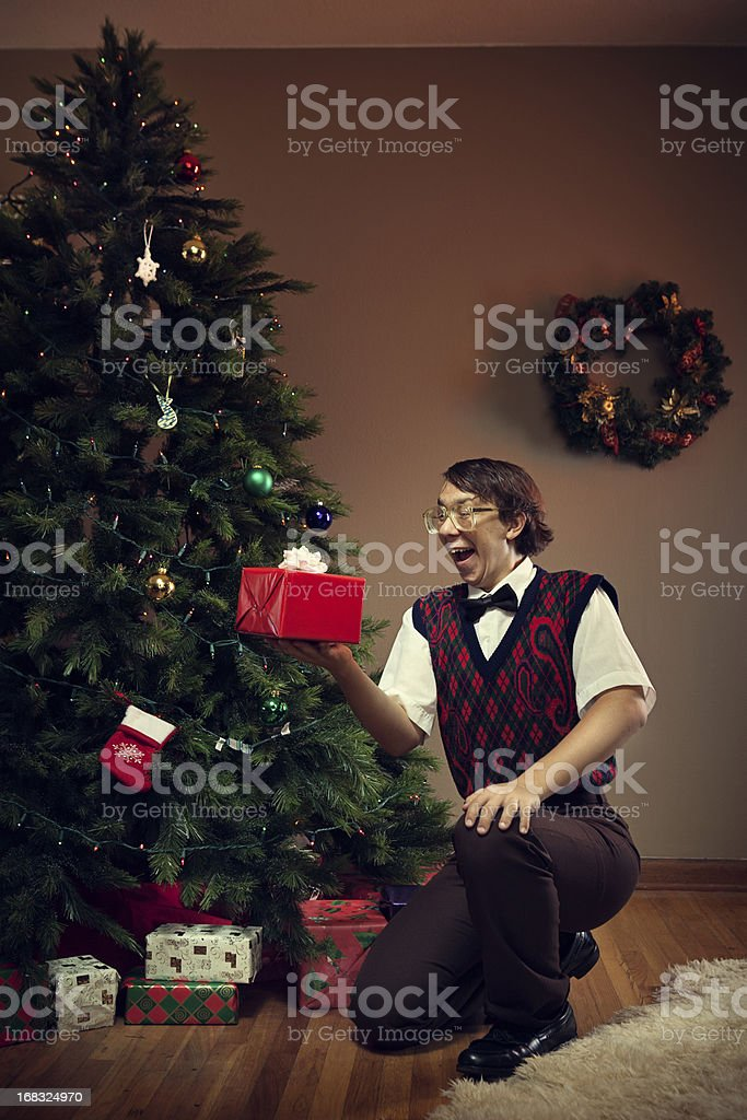 Christmas Nerd Child Receiving Gift stock photo