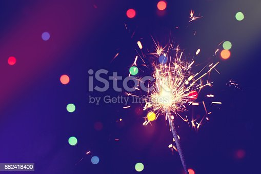 istock christmas, new year abstract background with sparkler 882418400
