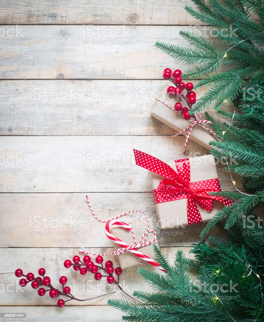 christmas new year background greeting card concept with green pine tree branches gift boxes with