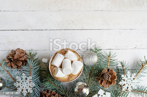 Christmas, new year decoration and cup of coffee on white wooden background with copy space. celebration winter card