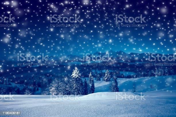 Photo of Christmas night with snowfall