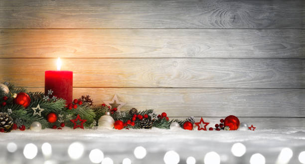 Christmas or Advent wood background with a candle stock photo