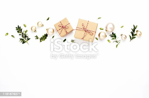Christmas or New Year background with gift boxes and Christmas tree decorations, flat lay arrangement, copy space for a text