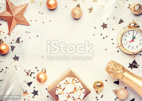 istock Christmas or New Year composition, frame, pink background with gold Christmas decorations, stars, snowflakes 1057913850