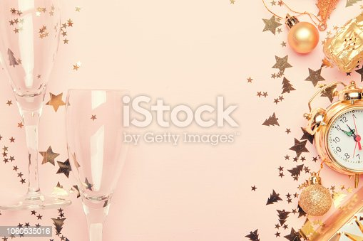 istock Christmas or New Year composition, frame, pink background with gold Christmas decorations 1060535016