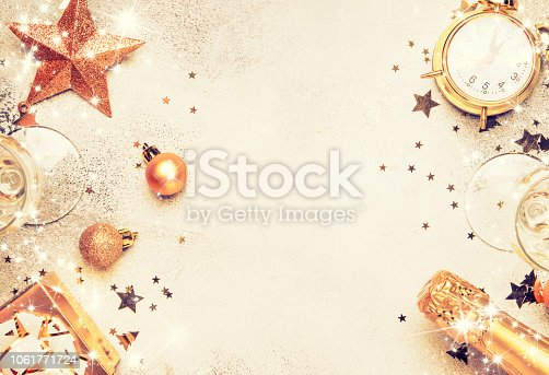 istock Christmas or New Year composition, frame, pink background with gold Christmas decorations 1061771724