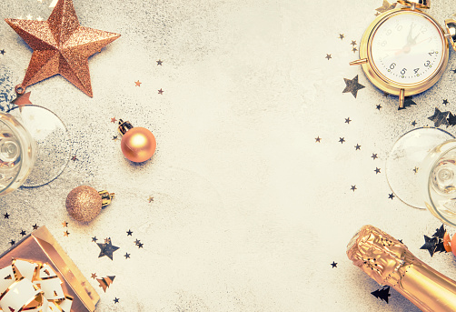 istock Christmas or New Year composition, gray background with gold Christmas decorations 1053649796