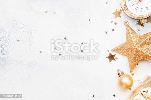 istock Christmas or New Year composition, gray background with gold Christmas decorations 1053649812