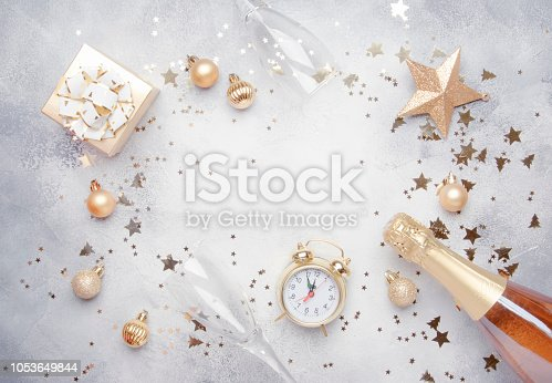 istock Christmas or New Year composition, gray background with gold Christmas decorations 1053649844