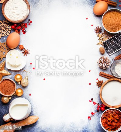 istock Christmas or New Year composition with ingredients for baking festive cookies, with golden snowflake 1057912448