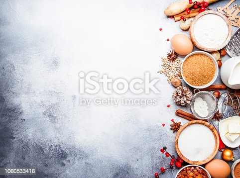 istock Christmas or New Year composition with ingredients for baking or cookies, with golden snowflakes 1060533416