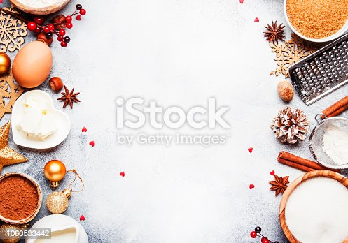istock Christmas or New Year composition with ingredients for baking or cookies, with golden snowflakes 1060533442
