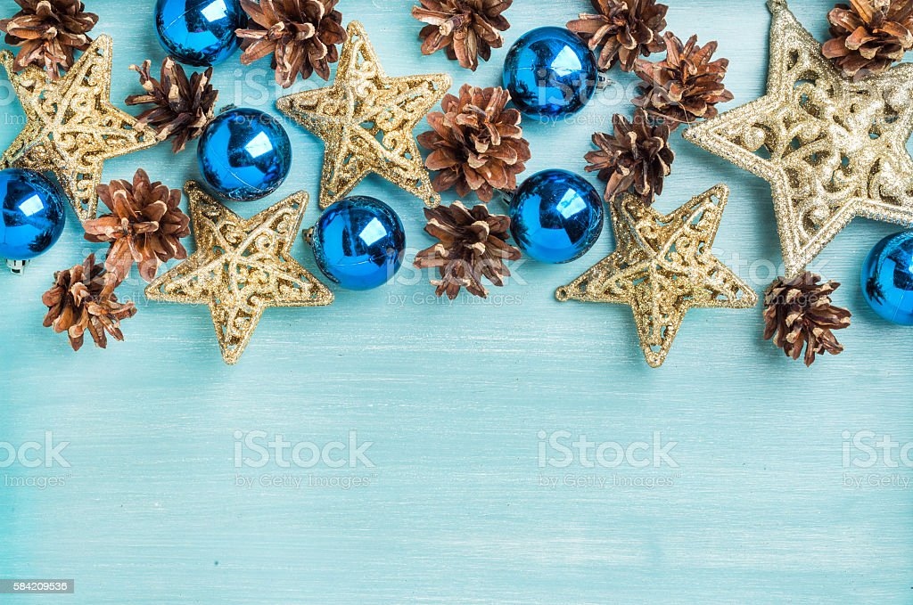 Christmas or new year decoration background: pine cones, blue glass stock photo