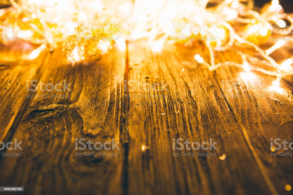 Christmas or New Year fairy lights on a wooden table stock photo