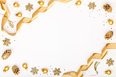 istock christmas or new year frame composition. christmas decorations in gold colors on white background with empty copy space for text. holiday and celebration concept for postcard or invitation. top view 868200420