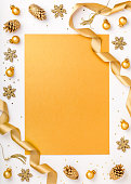 istock christmas or new year frame composition. christmas decorations in gold colors on white background with empty copy space for text. holiday and celebration concept for postcard or invitation. top view 868200568