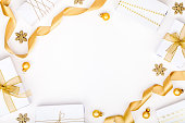 istock christmas or new year frame composition. christmas decorations in gold colors on white background with empty copy space for text. holiday and celebration concept for postcard or invitation. top view 868200624