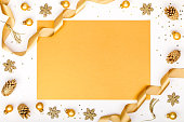 istock christmas or new year frame composition. christmas decorations in gold colors on white background with empty copy space for text. holiday and celebration concept for postcard or invitation. top view 875202956