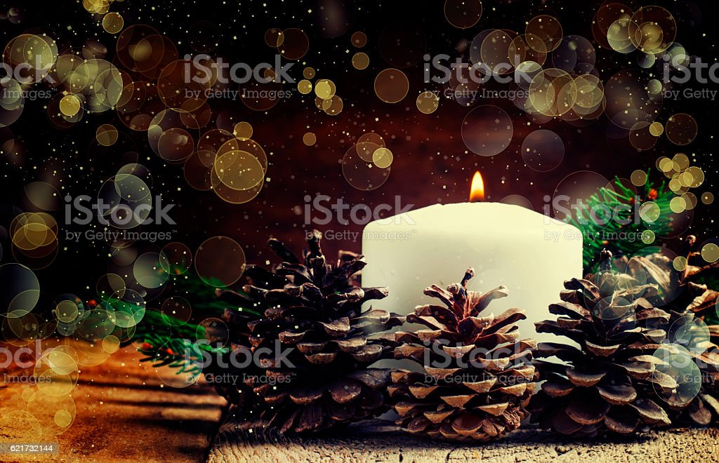 Christmas or New Year's composition with burning candle stock photo