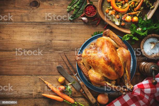 Christmas or Thanksgiving turkey on rustic wooden table