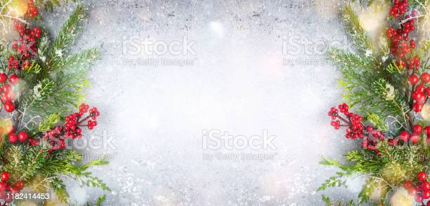 Christmas or winter background with a border of evergreen branches picture id1182414453?b=1&k=6&m=1182414453&s=612x612&h=h506whzdtpfpfdkfiypnsgzakkmtxmryrmltcebiaus=