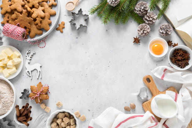 christmas or xmas baking culinary background. ingredients for cooking on kitchen table. new year or noel holiday festive decorations - christmas cooking imagens e fotografias de stock