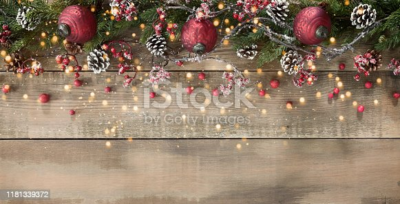 Christmas berry garland border on an old wood background