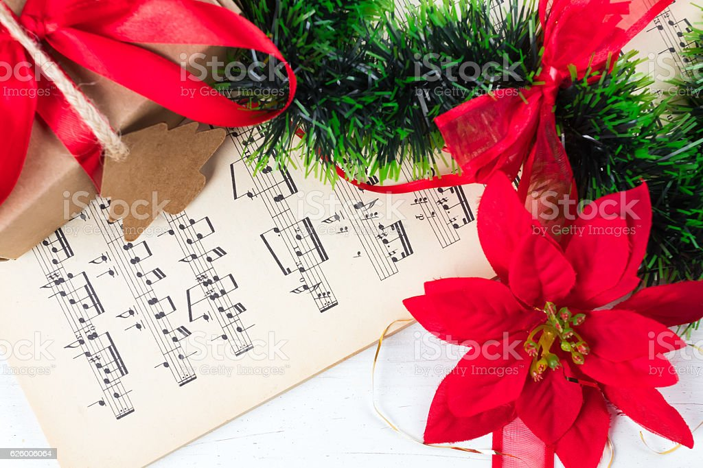 Christmas ornament and music sheet on white natural wooden table stock photo