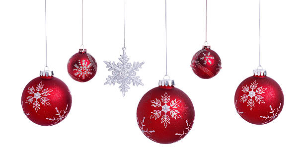 christmas ornament baubles and decorations hanging isolated on white - ornamentik stock-fotos und bilder