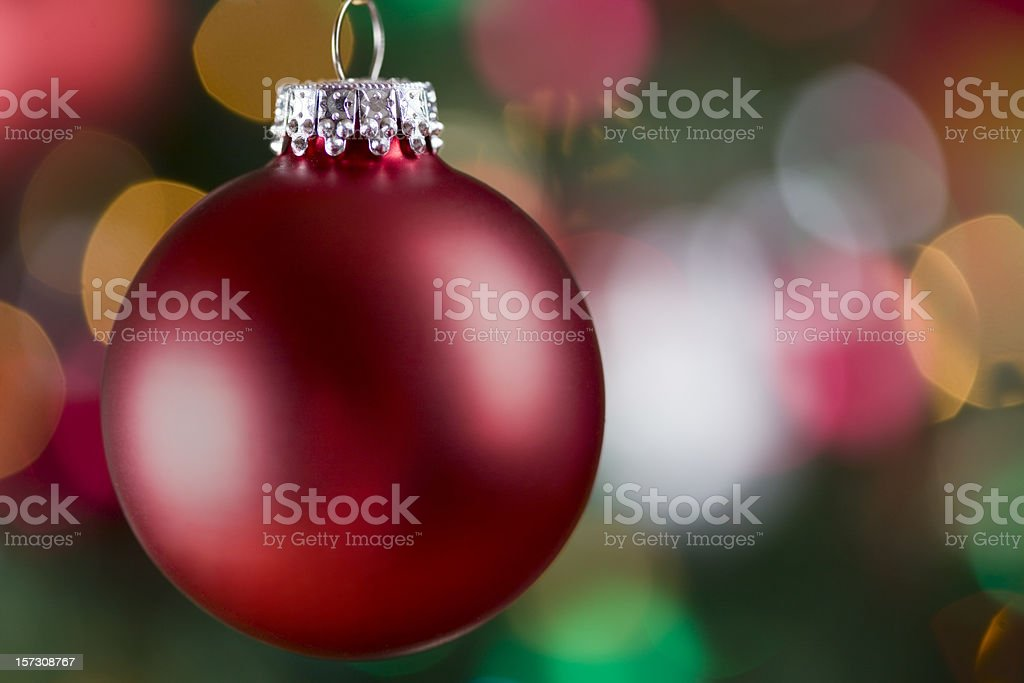 Christmas Ornament Close Up with Blurred Tree Lights, Copy Space royalty-free stock photo