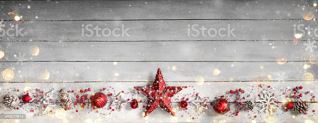 Christmas greeting card on vintage plank and red baubles