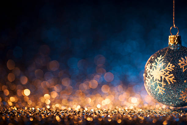 christmas ornament on defocused lights. decorations bokeh blue gold - ornamentik stock-fotos und bilder
