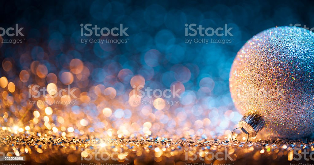 Christmas ornament on defocused lights. Decorations Bokeh Blue Gold - Photo