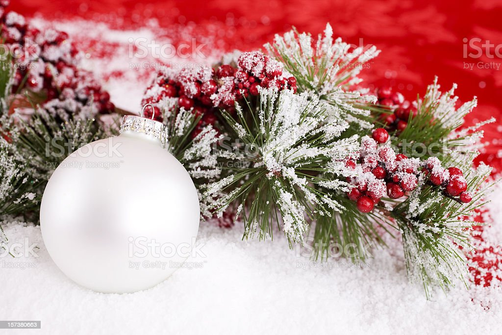 Christmas Ornament on Snowy Holly Branch, Copy Space stock photo