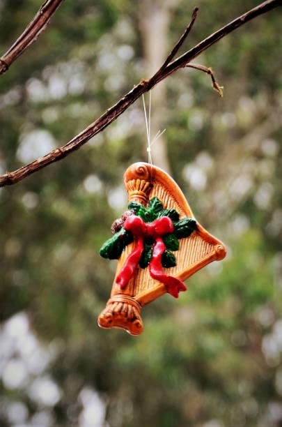 A christmas ornament shaped arpa hanging from the tree branch Uma arpa de natal pendurada no galho enfeitando árvore na praça ARPA stock pictures, royalty-free photos & images