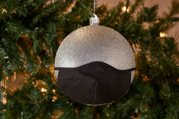 Christmas Ornament With Mask On. stock photo