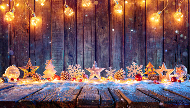 Christmas Ornament With String Lights On Rustic Wooden Table stock photo
