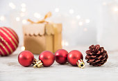 istock Christmas Ornaments And Gift On Wood Background 1072354118