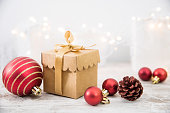 istock Christmas Ornaments And Gift On Wood Background 1072354120