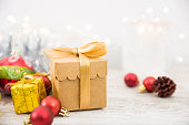 istock Christmas Ornaments And Gift With Christmas Lights Background 1072535408