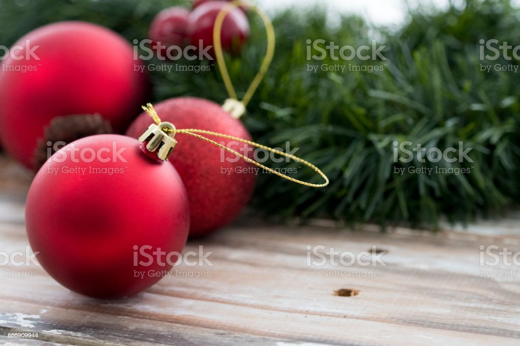 Photo of Christmas ornaments and ribbons on wooden background