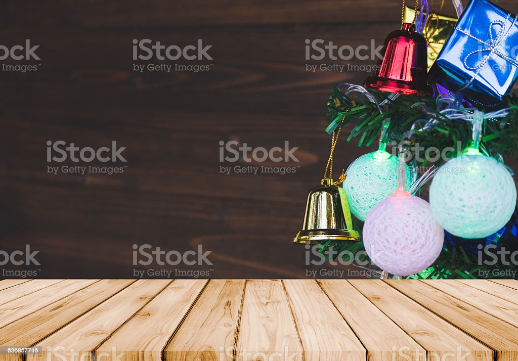 Christmas ornaments hang on Christmas tree with prespective wood. stock photo