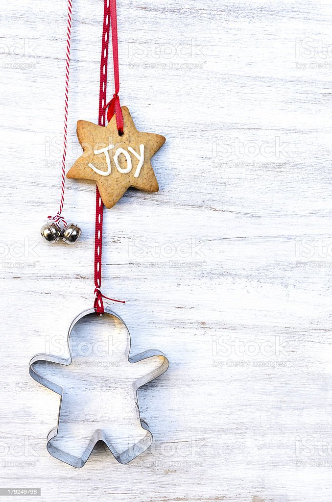 Christmas ornaments hanging against rustic background stock photo