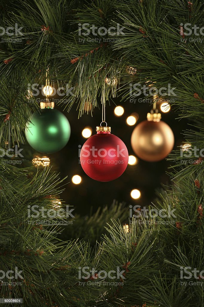Christmas ornaments hanging in the center of a wreath royalty-free stock photo