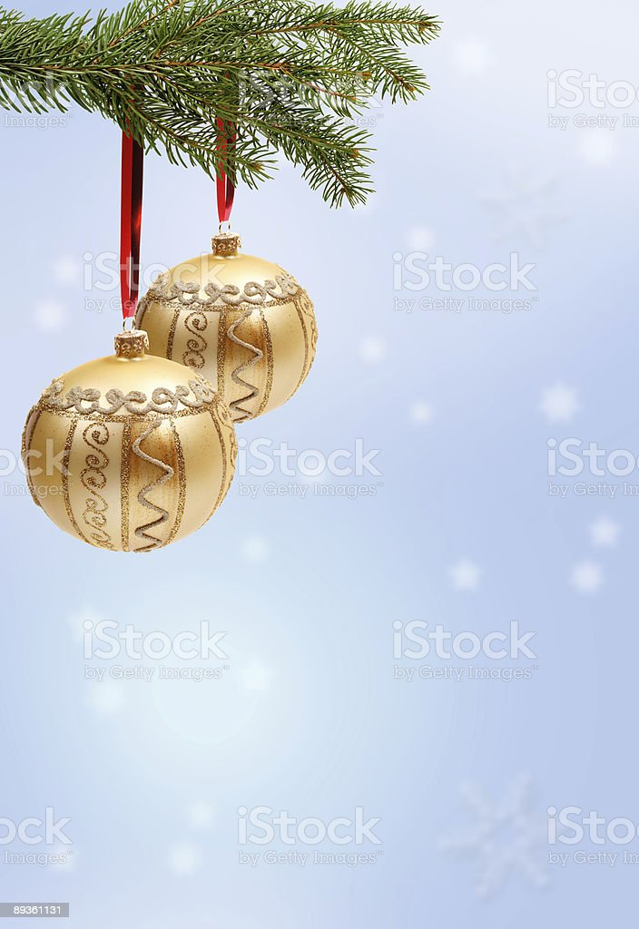 Christmas Ornaments on blue winter background royalty-free stock photo